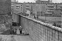 West German construction workers have a chat in West Berlin, April 18, 1967 beside the wall separating the city.