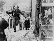 East German border guard Conrad Schumann leaps into the French Sector of West Berlin over barbed wire on August 15, 1961