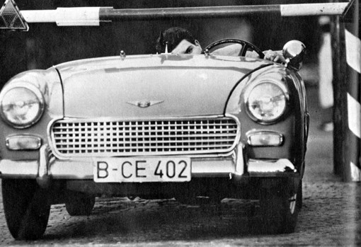 Heinz Meixner defects from East Germany by driving through Checkpoint Charlie after removing his windshield, 1963